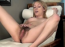 Hairy woman Melissa Delancey rubs her pussy lips