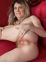 Ashleigh McKenzie strips naked on her red sofa